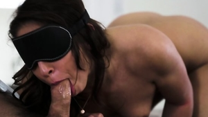 Blindfolded accompanied by brunette