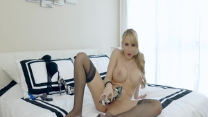 Blonde Katie Banks alongside Katie Morgan playing with toys