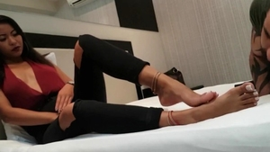 Footjob in company with kinky latina brunette