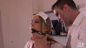 Blonde babe Candy Alexa raw bondage in the clinic