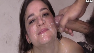 Cumshot accompanied by young brunette